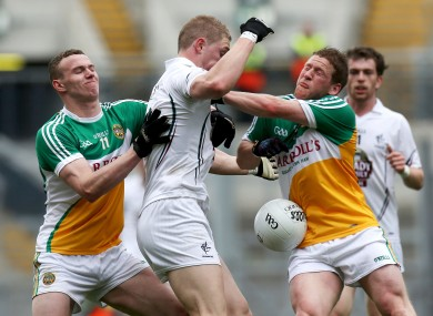 Offaly's Johnny Brickland and Brian Darby with Daniel Flynn of Kildare.