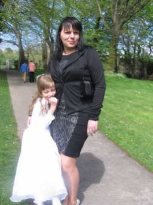 Jolanta Lubiene with her eight-year-old daughter Enrika at her Holy Communion in May.
