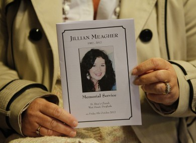 A mourner holds a mass card at the memorial mass for murdered Irish woman Jill Meagher at St Peter's Church, Drogheda.