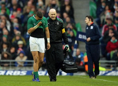 Simon Zebo (broken foot) is helped off the pitch by Dr Eanna Falvey.