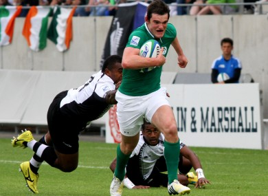 Tom Daly makes a break for Ireland.