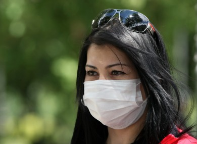 A Turkish woman affected by tear gas walks in the city center in Ankara