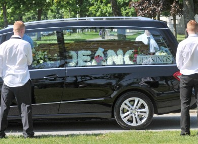 The hearse carrying Dean Fitzpatrick leaves his funeral mass at the Holy Trinity church in Donaghmede