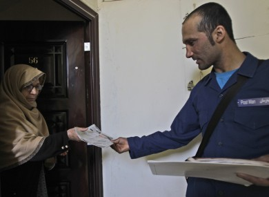 An Afghan postman delivering a letter in Kabul in 2011.