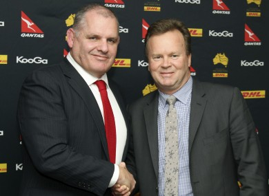 Ewen McKenzie, left, and Australian rugby union CEO Bill Pulver, right, shake on it.