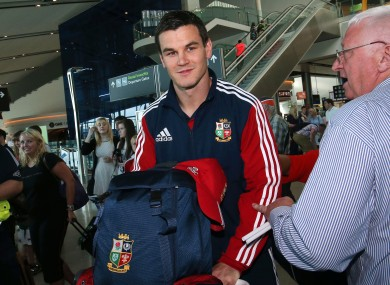 Jonathan Sexton arrives back in Dublin.