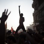 Egyptian protesters chant slogans against Egyptian Islamist President Mohammed Morsi in Tahrir Square in Cairo, Wednesday, July 3, 2013. A statement on the Egyptian president's office's Twitter account has quoted Mohammed Morsi as calling military measures