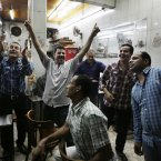Egyptians celebrate at a tea house during Defense Minister Gen. Abdel-Fattah el-Sissi's announcement in Cairo's Zamalek district Wednesday, July 3, 2013. A statement on the Egyptian president's office's Twitter account has quoted Mohammed Morsi as calling military measures