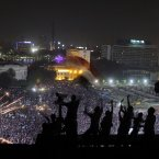 Egyptians wave national flags as fireworks light the sky over Tahrir Square, where hundreds thousands opponents of Egypt's Islamist President Mohammed Morsi celebrate in Cairo, Egypt, Wednesday, July 3, 2013. A statement on the Egyptian president's office's Twitter account has quoted Mohammed Morsi as calling military measures