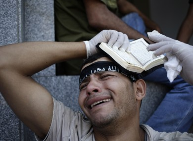 An Egyptian grieves for supporters of Egypt's ousted President Mohammed Morsi.