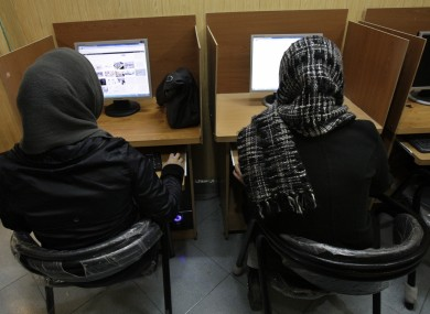 ranian women use computers at an Internet cafe in central Tehran, Iran