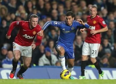 Wayne Rooney chases Eden Hazard at Stamford Bridge.