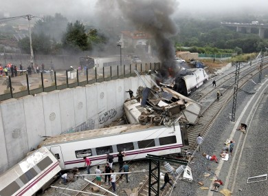 Emergency personnel respond to the scene of a train derailment in Santiago de Compostela, Spain.