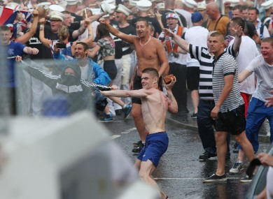 Loyalists clash with police in North Belfast on Friday.