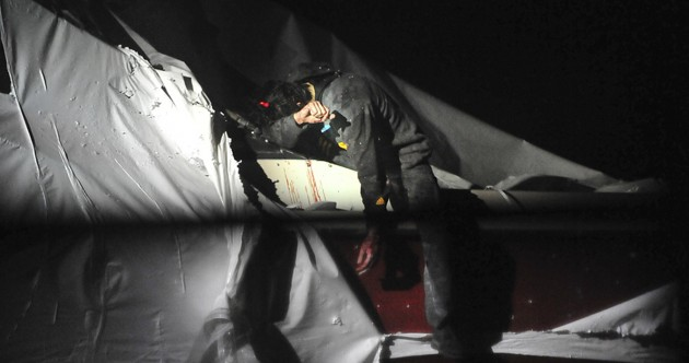 New images of the bloodied Boston Marathon bombing suspect's capture
