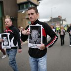 Sinn Fein supporters carry pictures of dead IRA volunteers . Pic: Julien Behal/PA Wire