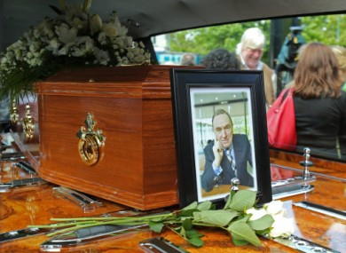 A portrait RTE presenter Colm Murray rests on his coffin at his funeral at St Gabriels Church in Dollymount, Dublin.