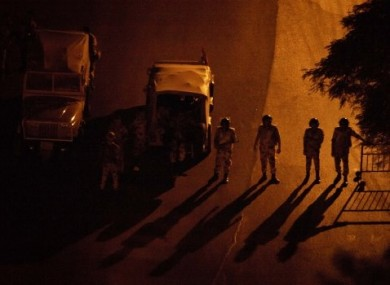 Egyptian soldiers stand guard at a checkpoint during a dawn-to-dusk curfew in the Zamalek district of Cairo.