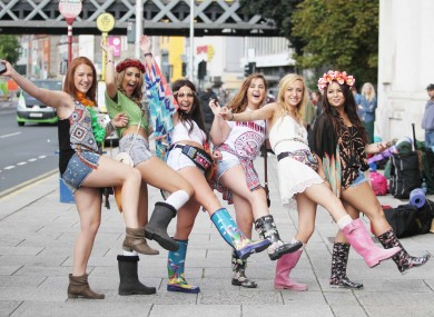 Girls from Donabate queue up to buy tickets before leaving for Electric Picnic at Custom House Quay in Dublin city on buses.