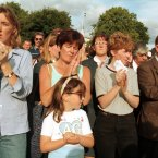 Young and old at a remembrance service in Omagh town wait for the clock to strike 3.10pm to mark the 29 people killed by a Real IRA car bomb one week earlier. (Pic taken on 22/8/1998 by Photocall Ireland)