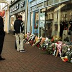 Flowers left at shops in Omagh town were 29 people were killed by the car bomb. (Pic: Photocall Ireland)