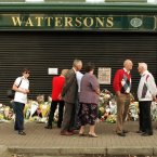 People leave flowers for the three Watersons book shop workers who were killed in the Omagh bomb - Geraldine Breslin (35), Veda Short (56) and Ann Mc Combe (48). (Pic: Photocall Ireland)