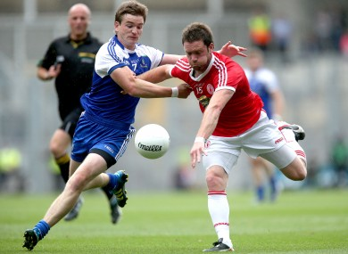 Monaghan's Dessie Mone and Martin Penrose of Tyrone do battle.