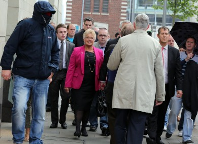 Patterson flanked by supporters as she leaves the courthouse