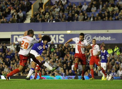 Everton's Marouane Fellaini scores his team's second goal of the game.