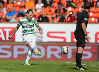 Anthony Stokes sends his free kick curling towards the Dundee United goal.
