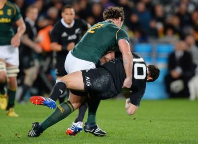 South Africa's Bismarck Du Plessis tackles Daniel Carter of the All Blacks.