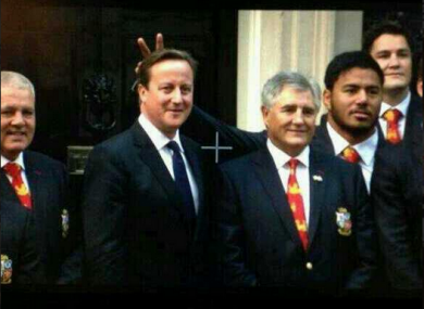 David Cameron gets the 'bunny ears' treatment from Manu Tuilagi.
