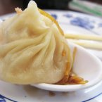 It's difficult to select just one dish for such a large and varied country as China, but xiaolongbao (soup dumplings) are certainly one of the country's most memorable foods.  Originally from Shanghai, these dumplings are usually filled with some sort of meat and soup broth and steamed in a bamboo basket. <span class=