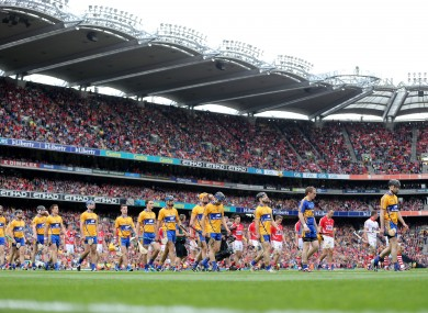 Cork and Clare players during the pre-match parade before their recent All