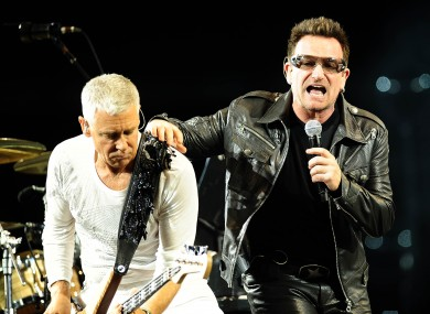 Adam and Bono, rocking out together in the past.