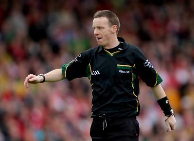 Man in the middle: Referee Joe McQuillan.