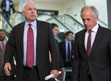 US Senator John McCain (left) with Senator Bob Corker, on their way to a closed-door briefing on Syria.