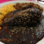 With up to 100 ingredients, mole sauce, suggested by Quora user Flor I., is one of the most complex and flavourful sauces in the world, resulting in a rich, creamy, chocolatey and spicy flavour.  It's originally from the Puebla and Oaxaca regions, but you can find mole sauce, usually doused over chicken or enchiladas, all across Mexico. <span class=