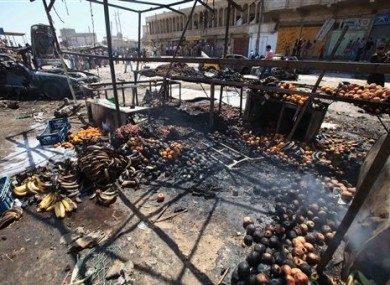 Remains of fruit smolder at the site of a car bomb attack at a vegetable market in Basra.