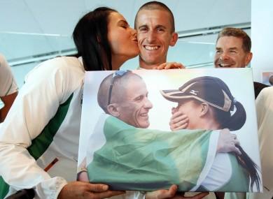 Marian Heffernan plants a kiss on husband Rob's cheek at his Dublin Airport homecoming.