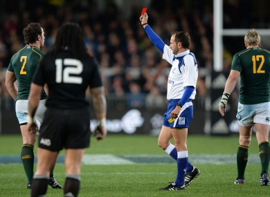 Romain Pite flashes the red card at Bismarck du Plessis.