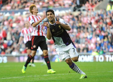 Liverpool's Luis Suarez celebrates scoring his side's third goal of the match.