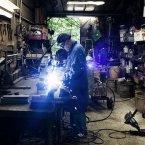 Bruno is seen welding in his workshop.<span class=