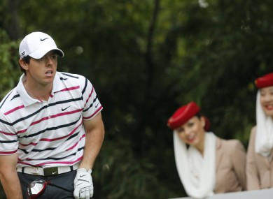 Mcllory watches his tee shot on the eighth hole during the first round of the HSBC Champions golf tournament at the Sheshan International Golf Club in Shanghai.