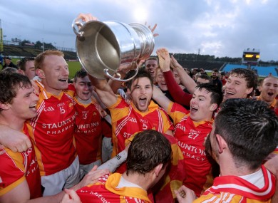 Castlebar Mitchels players celebrate.