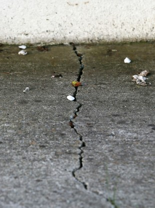 A crack in the ground outside a pyrite affected home in Dunshaughlin.