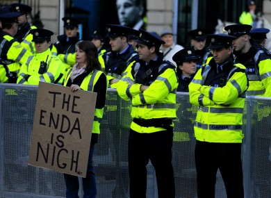 A protester with Garda outside Leinster House earlier.