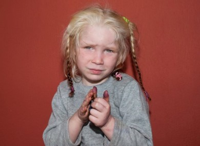 A photo of the girl released by a charity working to find her parents