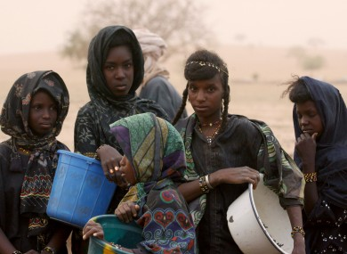 Nomadic Fulani girls wait to collect water from a public well in Gadabeji, Niger.