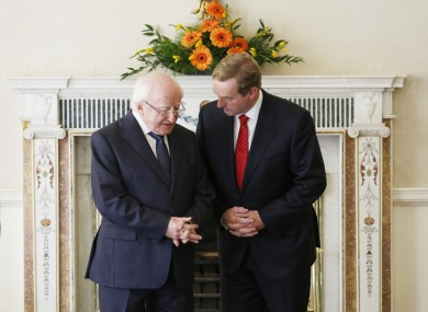 What do you think Enda is saying to Michael D?